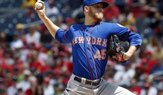 New York Mets starting pitcher Zack Wheeler throws during the third inning of a baseball game against the Washington Nationals at Nationals Park Sunday, May 18, 2014, in Washington. (AP Photo/Alex Brandon)