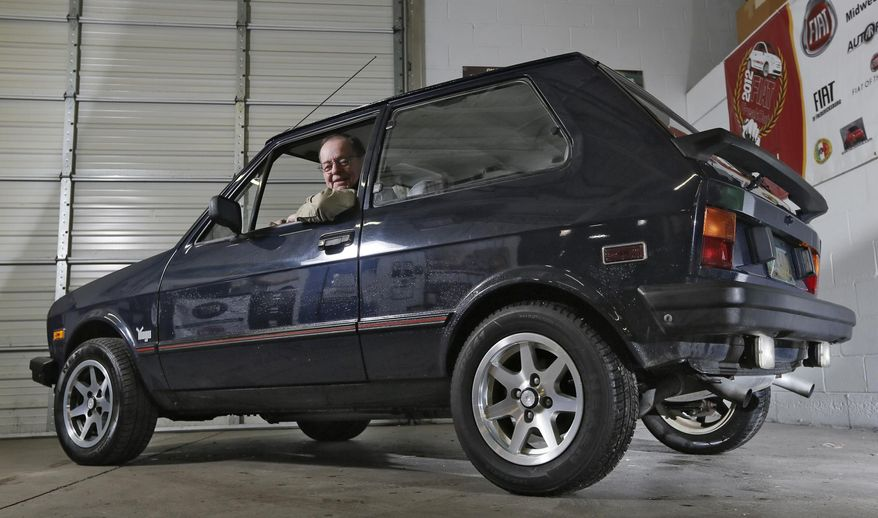 art hughes sits in his souped up yugo at the midwest bayless italian auto shop in columbus ohio. Black Bedroom Furniture Sets. Home Design Ideas