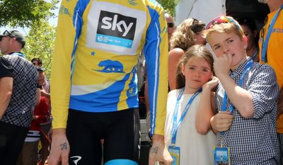 Bradley Wiggins, of Great Britain, the overall winner of the final stage of the Tour of California cycling race, waits backstage with his children Ben, 9, and Isabella, 7, in Thousand Oaks, Calif., Sunday, May 18, 2014. (AP Photo/Reed Saxon)