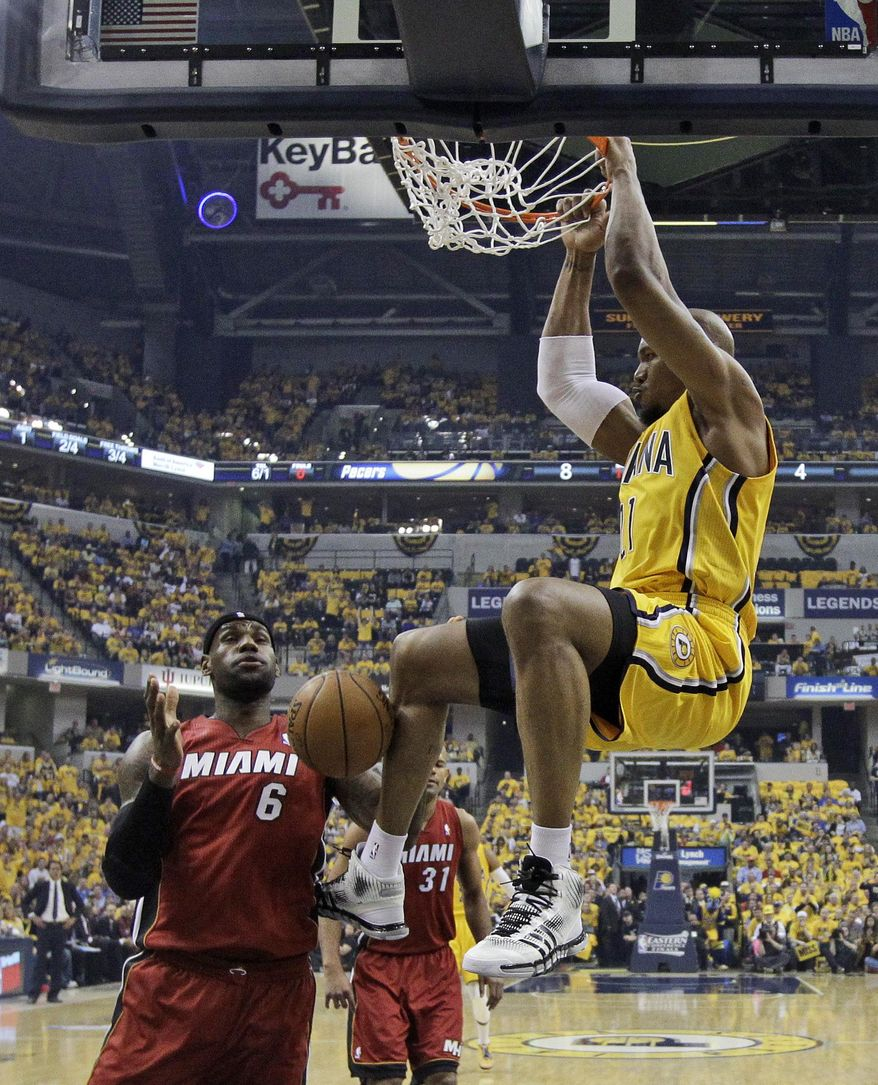 Indiana Pacers' David West dunks against Miami Heat's LeBron James during the first half of Game 1 of the Eastern Conference finals NBA basketball playoff series Sunday, May 18, 2014, in Indianapolis.  (AP Photo/Darron Cummings)