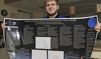 ADVANCE FOR USE SUNDAY, MAY 18 AND THEREAFTER - In this April 21, 2014 photo, Freeport, Ill., native Alec Mangan,17, displays designs he helped produce for the Orion spacecraft as part of an engineering competition sponsored by NASA. His team was one of five finalist teams in a NASA Exploration Design Challenge earlier this year.  (AP Photo/The Journal-Standard, Bill Rosemeier)