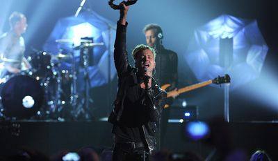 Ryan Tedder, of the musical group OneRepublic, performs at the Billboard Music Awards at the MGM Grand Garden Arena on Sunday, May 18, 2014, in Las Vegas. (Photo by Chris Pizzello/Invision/AP)