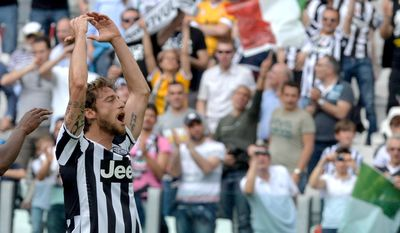 Juventus Claudio Marchisio celebrates after scoring during a Serie A soccer match between Juventus and Cagliari at the Juventus  Stadium in Turin, Italy, Sunday, May 18, 2014. (AP Photo/Massimo Pinca)
