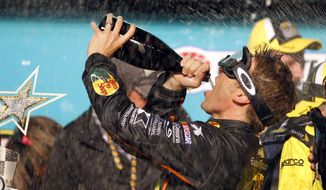 Jamie McMurray celebrates in Victory Lane after winning the NASCAR Sprint All-Star auto race at Charlotte Motor Speedway in Concord, N.C., Saturday, May 17, 2014. (AP Photo/Terry Renna)