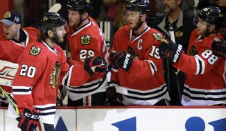 Chicago Blackhawks' Brandon Saad (20) celebrates with teammates after scoring a goal against the Los Angeles Kings during the first period in Game 1 of the Western Conference finals in the NHL hockey Stanley Cup playoffs in Chicago on Sunday, May 18, 2014. (AP Photo/Nam Y. Huh)