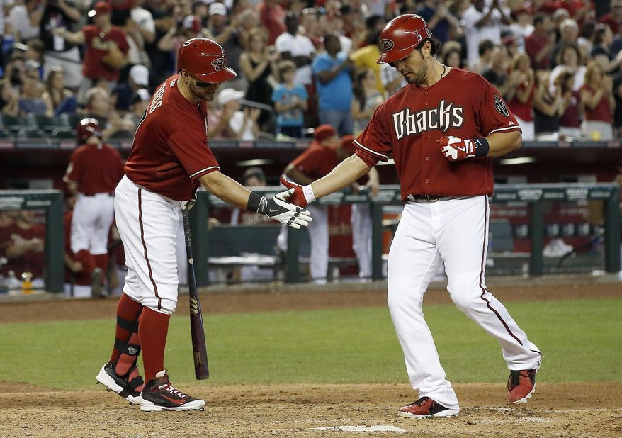 Arizona Diamondbacks' Eric Chavez, right, shakes hands with teammate Cody Ross as Chavez reaches home plate after hitting a 2-run home run against the Los Angeles Dodgers during the fifth inning of a baseball game on Sunday, May 18, 2014, in Phoenix. (AP Photo/Ross D. Franklin)