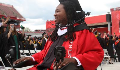 Paralyzed Rutgers football player Eric LeGrand enters High Point Solutions Stadium at the start of Rutgers University's 248th commencement, Sunday, May 18, 2014, in Piscataway, NJ. (AP Photo/Home News Tribune, Jason Towlen) NEWARK STAR LEDGER OUT, NO SALES