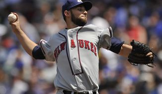 Milwaukee Brewers starter Marco Estrada delivers a pitch during the first inning of a baseball game against the Chicago Cubs in Chicago, Sunday, May 18, 2014. (AP Photo/Paul Beaty)