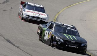 Sam Hornish Jr. leads Ryan Blaney, left, during the NASCAR Nationwide auto race, Sunday, May 18, 2014, at Iowa Speedway in Newton, Iowa. (AP Photo/Charlie Neibergall)