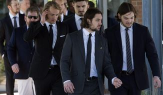 New York Rangers NHL hockey players leave the funeral home following funeral service's for France St. Louis, mother of New York Rangers hockey player Martin St. Louis Sunday, May 18, 2014 in Laval, Quebec. (AP Photo/The Canadian Press, Ryan Remiorz)