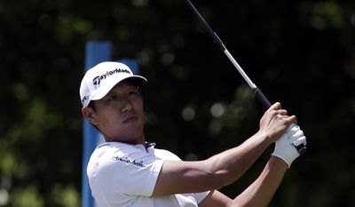 James Hahn follows his shot off the first tee during the final round of the Byron Nelson Championship golf tournament, Sunday, May 18, 2014, in Irving, Texas. (AP Photo/Tony Gutierrez)