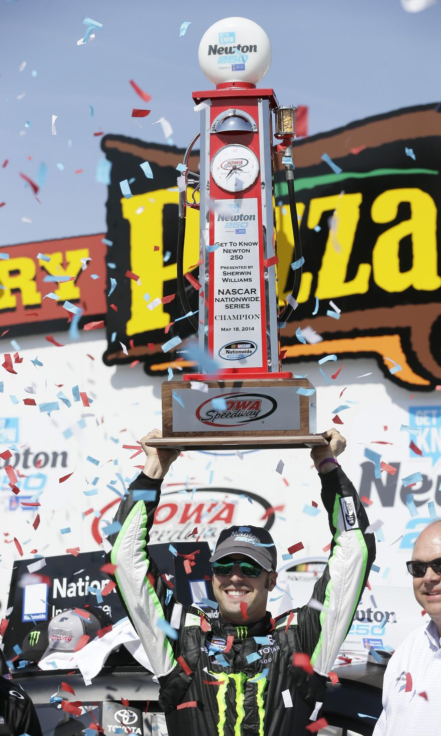 Sam Hornish Jr. holds the trophy after winning the NASCAR Nationwide auto race, Sunday, May 18, 2014, at Iowa Speedway in Newton, Iowa. (AP Photo/Charlie Neibergall)