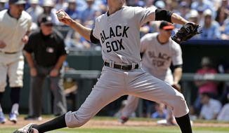 Baltimore Orioles starting pitcher Ubaldo Jimenez throws during the first inning of a baseball game against the Kansas City Royals Sunday, May 18, 2014, in Kansas City, Mo. (AP Photo/Charlie Riedel)