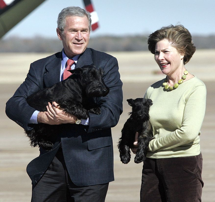 President Bush and first lady, Laura, carry their dogs, Barney and Miss Beazley, respectively, before departing from Waco, Texas on Marine One on their way to their ranch in Crawford for the remainder of the holiday, Monday,  Dec. 26, 2005. The first couple is scheduled to return to Washington after the New Year's holiday. (AP Photo/Lawrence Jackson)