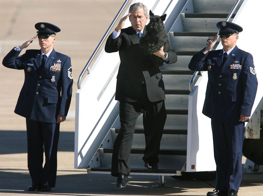 President Bush, along with his dog Barney, steps from Air Force One after landing Tuesday, Dec. 26, 2006, in Waco, Texas. The president will spend the week at his nearby ranch in Crawford. (AP Photo/Duane A. Laverty)