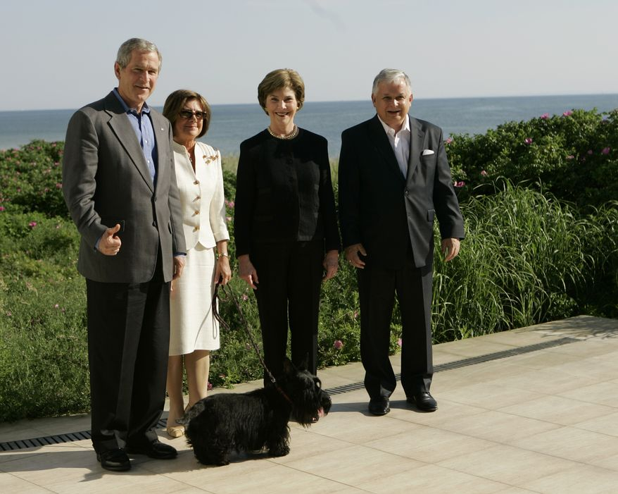 President Bush, left, gives a thumbs up when asked about his health as he poses for photographs with first lady Laura Bush, second from right, Polish President Lech Kaczynski and his wife Maria Kaczynski at the Presidential Retreat in Jurata Hel, Poland, Friday June 8, 2007. With them is the Kaczynski's dog 'Titus.' (AP Photo/Gerald Herbert)