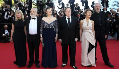 From second left, director Mike Leigh, actress Marion Bailey, actor Timothy Spall, actress Dorothy Atkinson and director of photography Dick Pope pose for photographers as they arrive for the screening of Mr. Turner at the 67th international film festival, Cannes, southern France, Thursday, May 15, 2014. (AP Photo/Alastair Grant)