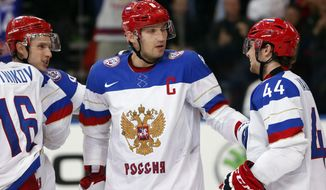 Russian players celebrate a goal during the Group B preliminary round match between Russia and Germany at the Ice Hockey World Championship in Minsk, Belarus, Sunday, May 18, 2014. (AP Photo/Darko Bandic)