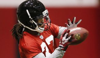 """Atlanta Falcons running back Devonta Freeman catches a pass at the teams NFL football rookie minicamp Sunday, May 18, 2014 in Flowery Branch, Ga.  When Freeman was selected by Atlanta in the fourth round, he said he """"felt like the first pick of the first round"""" due to the opportunity he sees with the Falcons. (AP Photo/John Bazemore)"""