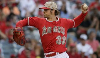 Los Angeles Angels starting pitcher C.J. Wilson throws to the Tampa Bay Rays during the first inning of a baseball game in Anaheim, Calif., Saturday, May 17, 2014. (AP Photo/Chris Carlson)