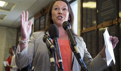 "FILE - In this May 21, 2013, file photo, Rep. Martha Roby, R-Ala., speaks to the reporters on Capitol Hill in Washington, Tuesday, May 21, 2013. Republicans hoping to ride Benghazi to a November sweep of midterm elections have entrusted a seven-member team, including Roby, with ""getting to the truth,"" in the words of House Speaker John Boehner, on whether the Obama administration misled Americans about the deadly attack.  (AP Photo/Manuel Balce Ceneta, File)"
