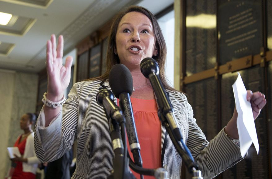 """FILE - In this May 21, 2013, file photo, Rep. Martha Roby, R-Ala., speaks to the reporters on Capitol Hill in Washington, Tuesday, May 21, 2013. Republicans hoping to ride Benghazi to a November sweep of midterm elections have entrusted a seven-member team, including Roby, with """"getting to the truth,"""" in the words of House Speaker John Boehner, on whether the Obama administration misled Americans about the deadly attack.  (AP Photo/Manuel Balce Ceneta, File)"""
