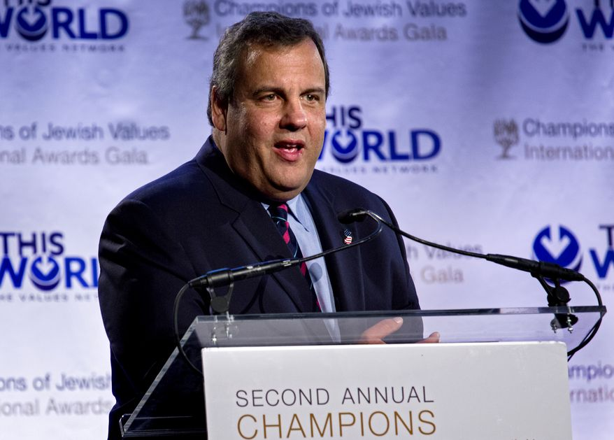 Keynote speaker  New Jersey Gov. Chris Christie addresses attendees at the Second Annual Champions of Jewish Values Awards Gala in New York Sunday, May 18, 2014. Right is Christie's wife Mary Pat. (AP Photo/Craig Ruttle)
