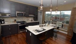 ADVANCE FOR MONDAY MAY 19 AND THEREAFTER This Monday April 28, 2014 photo shows the kitchen area of a Riverfront Residence Condos in Charleston, W.Va.  (AP Photo/Charleston Daily Mail, Lawrence Pierce)