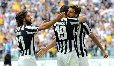 Juventus forward Fernando Llorente, right of Spain, celebrates with teammates andrea Pirlo, left, and Leoanrdo Bonucci  after scoring, during a Serie A soccer match between Juventus and Cagliari at the Juventus stadium, in Turin, Italy, Sunday, May 18, 2014. (AP Photo/Massimo Pinca)