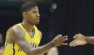 Indiana Pacers forward Paul George (24) gestures with Roy Hibbert against the Miami Heat during the first half of Game 1 of the Eastern Conference finals NBA basketball playoff series Sunday, May 18, 2014, in Indianapolis.  (AP Photo/Darron Cummings)