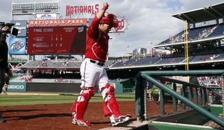 Washington Nationals catcher Wilson Ramos acknowledges the fans during after a baseball game against the New York Mets at Nationals Park Sunday, May 18, 2014, in Washington. Ramos had two hits for four RBI's. The Nationals won 6-3. (AP Photo/Alex Brandon)