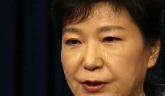 South Korean President Park Geun-hye weeps while delivering a speech to the nation about the sunken ferry Sewol at the presidential Blue House in Seoul, South Korea, Monday, May 19, 2014. South Korea's president said Monday she will push to disband the coast guard in the wake of last month's ferry disaster that left more than 300 people dead or missing, calling its rescue operations after the disaster a failure. (AP Photo/Yonhap, Do Kwang-hwan) KOREA OUT