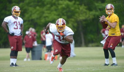 Roderick McDowell, one of 38 on the minicamp tryout roster, runs a pass route during running back drills at rookie minicamp on Saturday, May 17 at Redskins Park in Ashburn.  Khalid Naji-Allah/ Special to The Washington Times
