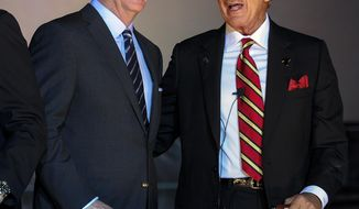 NFL football commissioner Roger Goodell, left, and Atlanta Falcons owner Arthur Blank talk during the ground breaking ceremony for the new stadium to be the home of the Atlanta Falcons, held Monday, May 19, 2014, in Atlanta. (AP Photo/John Amis)