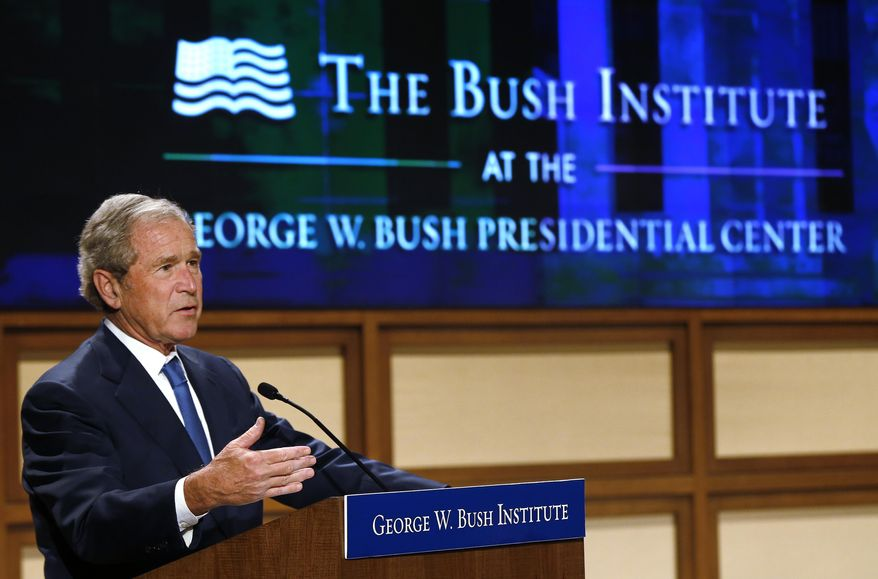 Former President George W. Bush makes remarks during the Monetary Policy and the Economy, a conference examining central banking impact on prosperity on Monday, May 19, 2014, at the George W. Bush Presidential Center in Dallas. (AP Photo/The Dallas Morning News, David Woo) MANDATORY CREDIT; MAGS OUT; TV OUT; INTERNET USE BY AP MEMBERS ONLY; NO SALES.