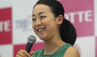 Japanese figure skaters Mao Asada speaks during a press conference in Tokyo, Monday, May 19, 2014.  Asada said she is taking a season off from competitive skating but said there is a 50 percent chance she will return to the sport. (AP Photo/Koji Sasahara)