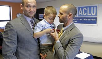 FILE - In this Jan. 21, 2014, file photo, plaintiffs Matthew Barraza, left, looks on as his husband Tony Milner, right, holds their son Jesse, 4, following a news conference in Salt Lake City. A federal judge Monday, May 19, 2014, ordered Utah officials to recognize more than 1,000 same-sex marriages that took place in the state before the U.S. Supreme Court issued an emergency stay. The American Civil Liberties Union filed the lawsuit in January on behalf of four couples who said the state's decision to freeze benefits for same-sex couples violated their right. Barraza and Milner were one of the four couples who sued. Only Barraza is legally recognized as a parent of Jesse. (AP Photo/Rick Bowmer, File)