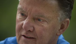 "Louis van Gaal, coach of the Dutch national soccer team, talks after a training in Hoenderloo, eastern Netherlands, Thursday, May 15, 2014. The 62-year-old coach, who is widely expected to be the manager of Manchester United next season, has been experimenting in recent days with a new formation which he says may sound more defensive, but will be executed according to the ""Dutch school"" of attacking football. (AP Photo/Peter Dejong)"