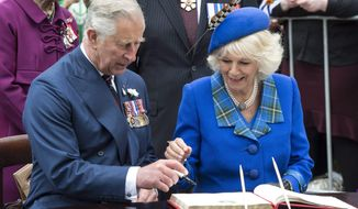 Prince Charles hands the pen over to his wife, Camilla, The Duchess of Cornwall, as they sign a guest book during welcoming ceremonies Monday, May 19, 2014 in Halifax, Nova Scotia. The Royal couple are on a four-day tour of Canada. (AP Photo/The Canadian Press, Paul Chiasson)