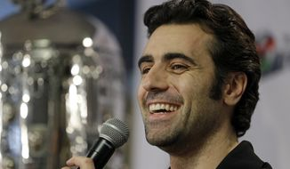 FILE - In this Dec. 19, 2013 file photo, Dario Franchitti, of Scotland, answers a question during  his first public appearance since a crash ended his IndyCar career during a press conference in Indianapolis. The three-time Indy 500 winner scoots through the Indianapolis Speedway paddock in a golf cart. Aside from a team meeting here or there, he marches to a wide-open schedule. Retirement suits the Scotsman well.  (AP Photo/Michael Conroy, File)