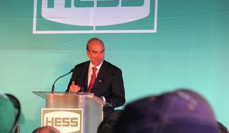 Hess Corp. CEO John Hess addresses company workers and dignitaries at a celebration of the company's upgraded gas plant in Tioga, N.D. on Monday, May 19, 2014. The upgraded plant is set to reduce the company's natural gas flaring in the state from 25 percent to between 15 and 20 percent. (AP Photo/Josh Wood)