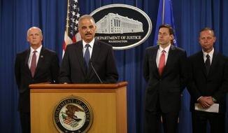 Attorney General Eric Holder, accompanied by, from left, U.S. Attorney for Western District of Pennsylvania David Hickton,  Assistant Attorney General for National Security John Carlin, and FBI Executive Associate Director Robert Anderson, speaks at a news conference at the Justice Department in Washington, Monday, May 19, 2014. Holder was announcing that a U.S. grand jury has charged five Chinese hackers with economic espionage and trade secret theft, the first-of-its-kind criminal charges against Chinese military officials in an international cyber-espionage case. (AP Photo/Charles Dharapak)