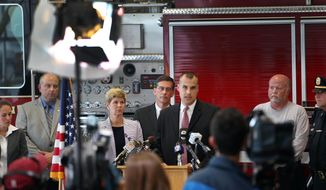 Sgt. Ebert Joseph from the New Hampshire state police speaks at a press conference Monday May 19, 2014 in Brentwood, N.H. after concluding their investigation into the death of Brentwood Officer Stephen Arkell. Authorities say the house was set on fire in several locations, and that the fire overwhelmed a sprinkler system before mixing with leaking propane to cause the explosion. The leak was attributed to bullets hitting the gas line.( AP Photo/Jim Cole)