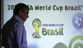 Greece soccer coach Fernando Santos of Portugal arrives to announce the national soccer squad in Athens on Monday May 19, 2014. Greece will play in Group C with Ivory Coast, Japan and Colombia at the World Cup in Brazil. (AP Photo/Thanassis Stavrakis)