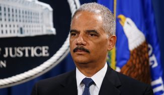Attorney General Eric Holder listens during a news conference at the Justice Department in Washington, Monday, May 19, 2014. Holder announced that a U.S. grand jury has charged five Chinese hackers with economic espionage and trade secret theft, the first-of-its-kind criminal charges against Chinese military officials in an international cyber-espionage case. (AP Photo/Charles Dharapak)