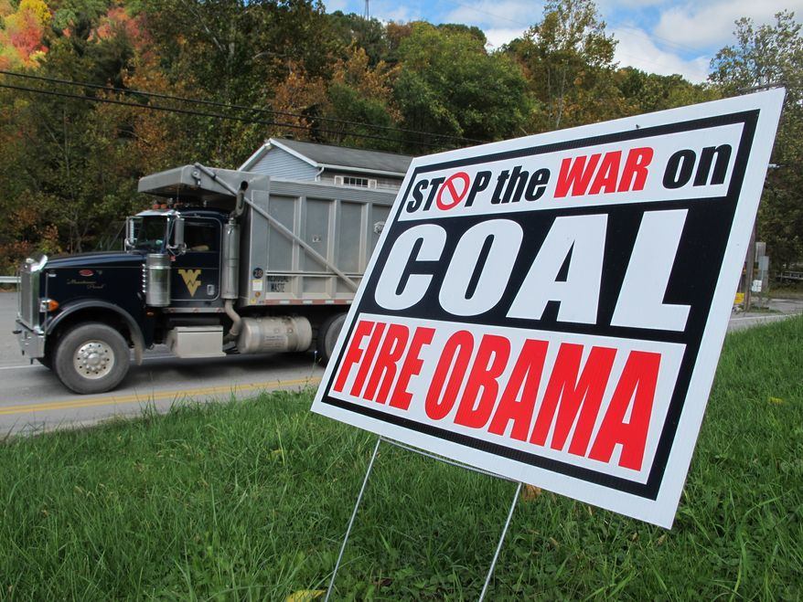 """New EPA rules on coal-fired power plants will in effect """"ban one of America's most abundant energy sources, coal"""" and """"drive up electricity costs,"""" writes Ben Carson. (AP Photo/Vicki Smith)"""