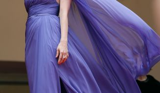 Actress Jessica Chastain poses for photographers as she arrives for the screening of Foxcatcher at the 67th international film festival, Cannes, southern France, Monday, May 19, 2014. (AP Photo/Alastair Grant)