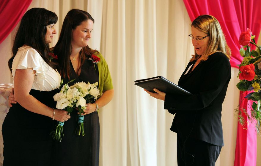 Julia Fraser, left, and Jessica Rohrbacher  get married by Holly Pruett at the Melody Ballroom in Portland, Ore. on Monday, May. 19, 2014. Federal Judge Michael McShane released an opinion Monday on Oregon's Marriage Equality lawsuit that grants gay and lesbian couples the freedom to marry in Oregon.  (AP Photo/Steve Dykes)