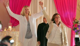 Julie Engbloom, left, and Laurie Brown, right, get married by Judge Beth A. Allen at the Melody Ballroom, Monday, May 19, 2014,  in Portland, Ore. Federal Judge Michael McShane released an opinion on Oregon's Marriage Equality lawsuit that grants gay and lesbian couples the freedom to marry in Oregon. (AP Photo/Steve Dykes)