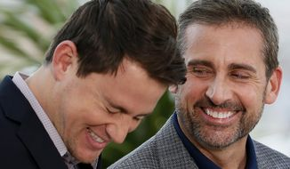 Actors Steve Carell, right, and actor Channing Tatum laugh during a photo call for Foxcatcher at the 67th international film festival, Cannes, southern France, Monday, May 19, 2014. (AP Photo/Alastair Grant)